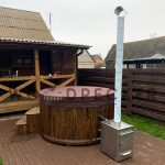 Hot tub with outside heater
